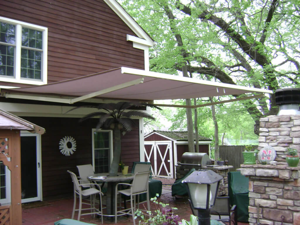 Shady Backyard Patio with Retractable Awning